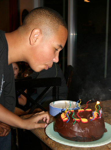 Nate blowing out candles